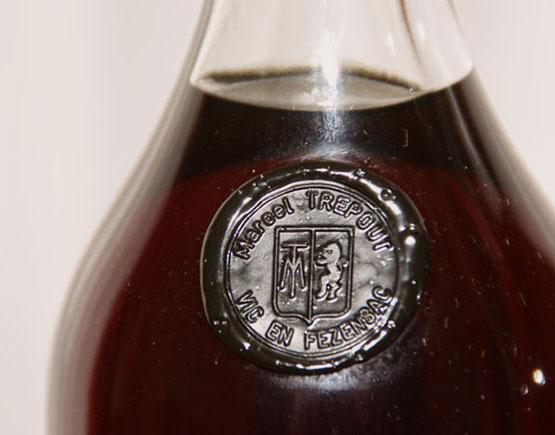 Armagnac-Marcel-Trepout-bottle-logo